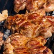 Juicy pork meat on grill — Stock Photo