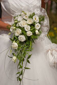 Bride with bridal bouquet of white flowers — Stock Photo
