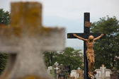 Jesus Christ on cross imposing in cimitir — Stock Photo