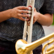Stock Photo: Musicians playing trumpets of different colors