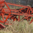 Stock Photo: Front wheel of harvesting combine