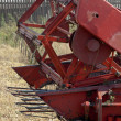 Side view of harvesting combine threshing grain on the field — Stock Photo