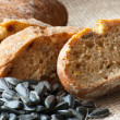 Foto Stock: Black bread with sunflower seeds