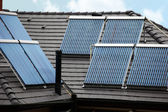Six solar thermal tubes on rooftop — Foto Stock