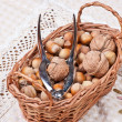 Handpiece for cracking nuts in basket — Stock Photo