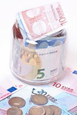 Banknotes in jar — Stock Photo