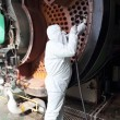 Stock Photo: Industrial steam boiler being cleaned