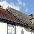 Thatched to tiled roof — Stock Photo