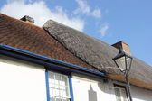 Thatched to tiled roof — ストック写真