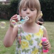 Stock Photo: Blowing bubbles