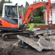 Stock Video: Mini digger excavating driveway