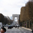 Arc de triomphe in Paris, street, road in winter - Stock Photo