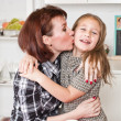 Mother embraces and kisses the daughter — Stock Photo