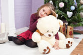The girl with a plush toy — Stock Photo