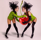 Two girls with huge cherry — Stock Photo
