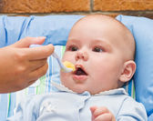 Baby boy while mother feeding — Stock Photo
