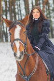 Beautiful woman and horse in winter — Stock Photo