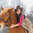 Stock Photo: WomRiding Horse Snow
