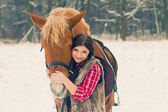 Woman with a Horse the Snow — Stock Photo