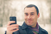 Man expresses emotion with mobile phone — Stock Photo