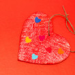 Stock Photo: Multicolored paper hearths on a wooden red heart