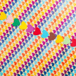 Line of multicolored paper hearths — Stock Photo