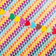 Line of multicolored paper hearths — Stock Photo #18162033