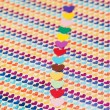 Stock Photo: Line of multicolored paper hearths