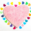 Multicolored paper hearths on a wooden pink heart — Foto Stock
