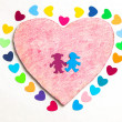 Multicolored paper hearths with  a wooden pink heart and paper boy and girl — Stok fotoğraf