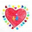 Multicolored paper hearths on a wooden red heart and paper boy and girl — Foto de Stock