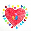 Multicolored paper hearths on a wooden red heart and paper boy and girl — Stock Photo #18162305