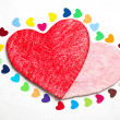 Multicolored paper hearths with a wooden red and pink hearts — Stock Photo
