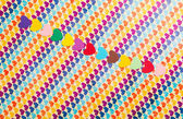 Line of multicolored paper hearths — 图库照片