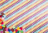 Corner of multicolored paper hearths — Stock Photo