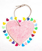 Multicolored paper hearths with a wooden pink heart — Stock Photo