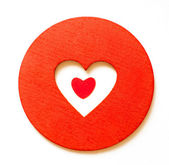 Red paper hearth inside a wooden red heart — Stock Photo