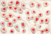 Stones painted with red hearts — Stock Photo