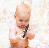 Baby with mobile phone — Stock Photo