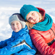 mother and child  in snow — Stock Photo