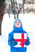 Boy with Christmas present — Stock Photo