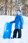 Young boy with sled — Stock Photo