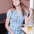 Young woman drinking lager — Stock Photo