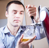 Barman draft beer — Stock Photo
