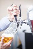 Barman draft beer — Stock Photo