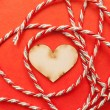 Wood heart with gift ribbon - Stock Photo