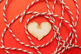Wood heart with gift ribbon — Stock Photo