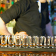 Barman making  drink shots - Stock Photo