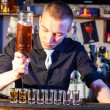Barman making drink shots — Stock Photo #19911129
