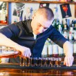 Barman making drink shots — Stock Photo